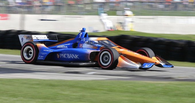 IndyCar driver Scott Dixon (9) is a blur of speed as he exits Turn 5 during the REV Group Grand Prix auto race one, Saturday, July 11, 2020, in Elkhart Lake, Wis. Dixon went on to win the event. (Gary C. Klein/The Sheboygan Press via AP)