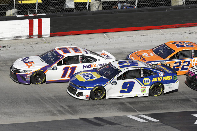 Denny Hamlin (11) drives followed by Chase Elliott (9) and Joey Logano (22) during a NASCAR Cup Series auto race at Bristol Motor Speedway Sunday, May 31, 2020, in Bristol, Tenn. (AP Photo/Mark Humphrey)