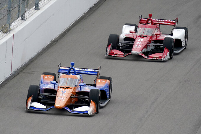 Scott Dixon (9) races followed by Marcus Ericsson (8) during the IndyCar auto race at World Wide Technology Raceway on Saturday, Aug. 29, 2020, in Madison, Ill. (AP Photo/Jeff Roberson)
